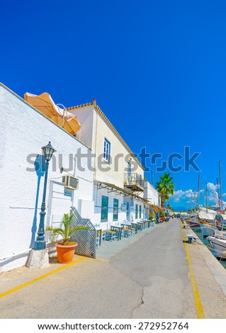 beautiful buildings by the sea in Spetses island in Greece - stock photo