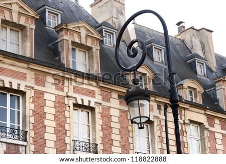 Beautiful buildings of Place des Vosges, square in Paris, France, - stock photo