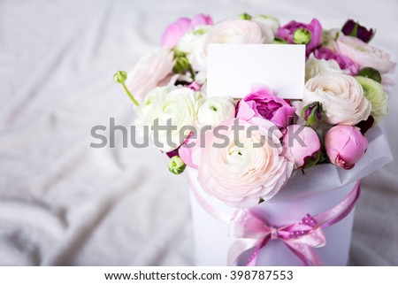 beautiful bunch of summer flowers with blank card over white background