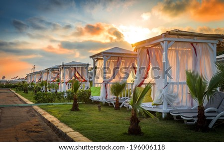 Beautiful bungalows for relaxation on the beach - stock photo