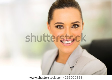 beautiful business executive looking at the camera - stock photo