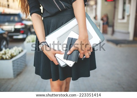 Beautiful Business Girl in the City with Documents - stock photo