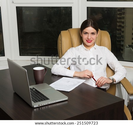 Beautiful business lady in office