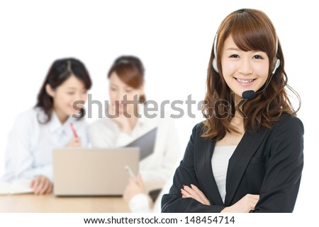 Beautiful business operator on white background - stock photo
