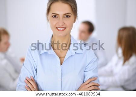 Beautiful business woman at meeting - stock photo