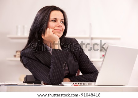 beautiful business woman at the workplace in office - stock photo