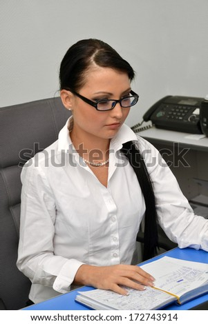 Beautiful business woman at work  - stock photo