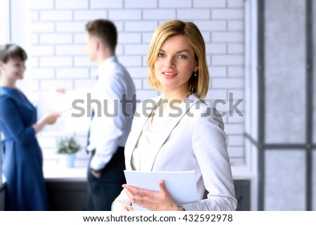 Beautiful business woman. business colleagues analyzing financial figures on a graphs - stock photo
