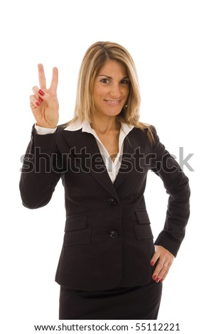 Beautiful business woman doing a victory sign - stock photo