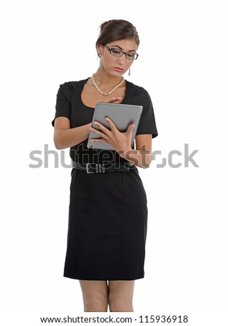 Beautiful business woman dress in black with a tablet computer in her hands