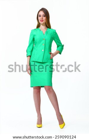 beautiful business woman fashion model girl in summer green suit - stock photo