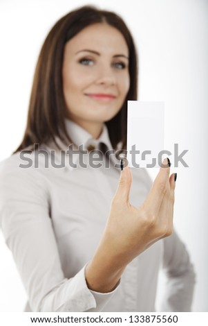 beautiful business woman holding a blank card in her hand on white background. - stock photo