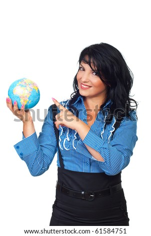 Beautiful business woman holding a globe  and pointing to object isolated on white background