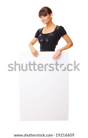 Beautiful business woman holding empty white board - stock photo