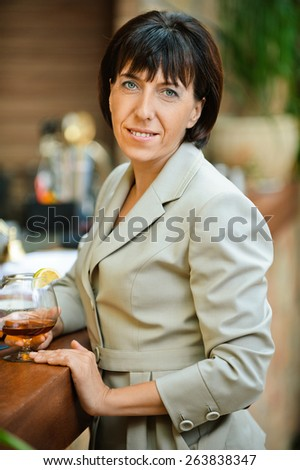 Beautiful business woman holding glass of wine at corporate events.