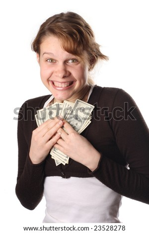 Beautiful business woman holding money and smiling - stock photo