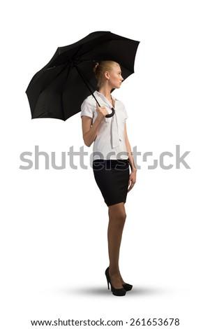 Beautiful business woman holding umbrella isolated on white background - stock photo