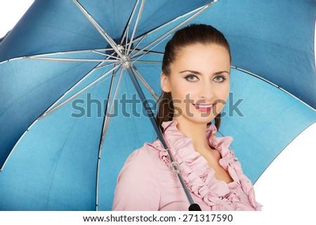 Beautiful business woman is holding blue umbrella.  - stock photo