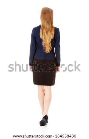 Beautiful business woman is looking up, rear view. Isolated on white. - stock photo