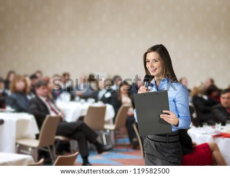 Beautiful business woman is speaking on conference. - stock photo