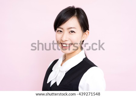 beautiful business woman isolated against pink background - stock photo