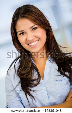 Beautiful business woman looking very happy  at the office