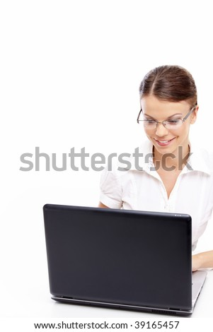 Beautiful business woman looks in the screen of the laptop isolated