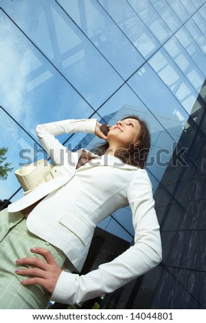 beautiful  business woman on the phone at modern building - stock photo