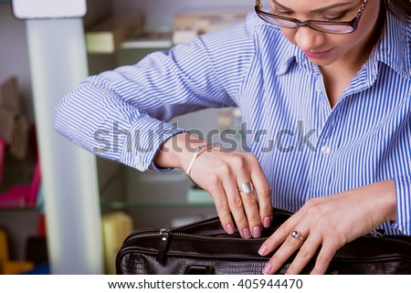 Beautiful Business woman opens a briefcase.