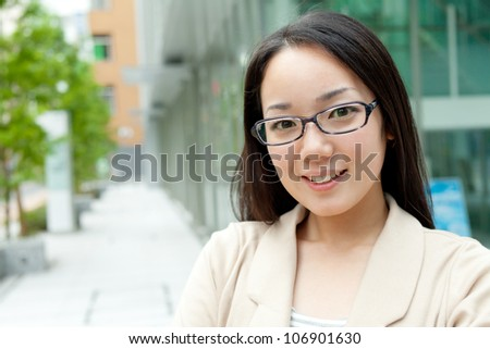 Beautiful business woman outdoor. Portrait of asian. - stock photo