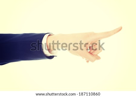 Beautiful business woman pointing. Isolated on white. - stock photo