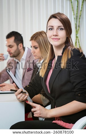 Beautiful business woman portrait, business people in office. Shallow depth of field.