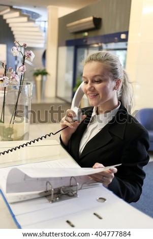 Beautiful business woman portrait in a modern office - stock photo