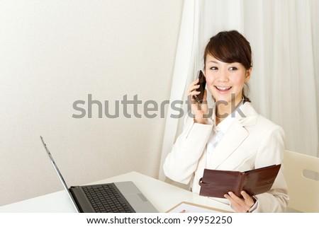 Beautiful business woman. Portrait of asian woman. - stock photo