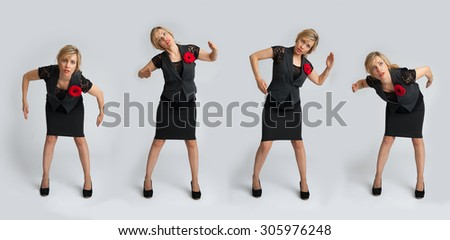Beautiful business woman posing on a gray background - stock photo