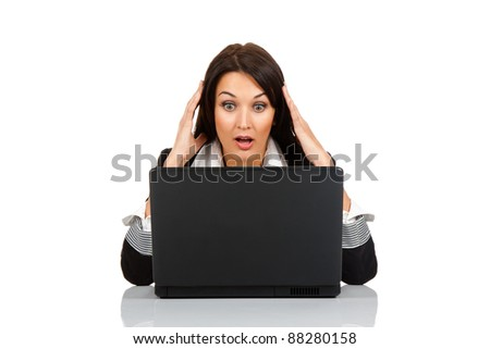 beautiful business woman scared, terrified sitting at the desk working using laptop looking at screen, isolated over white background, computer problem concept