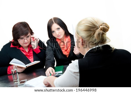 Beautiful business woman sharing ideas with each other. Shot in the studio against an isolated white background.  - stock photo