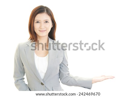 Beautiful business woman showing something with her hand - stock photo