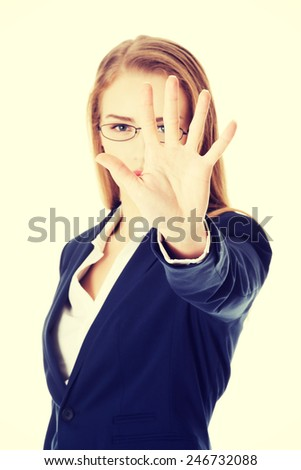 Beautiful business woman showing stop gesture by hand.  - stock photo