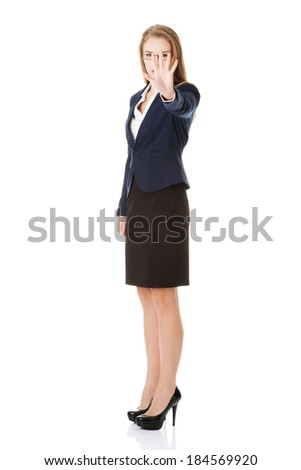 Beautiful business woman showing stop gesture by hand. Isolated on white. - stock photo