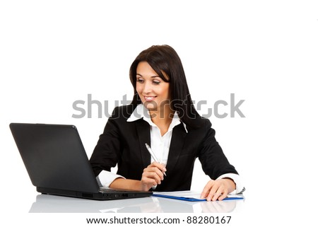 beautiful business woman smile sitting at the desk working using laptop looking at screen, hand writing, isolated over white background - stock photo