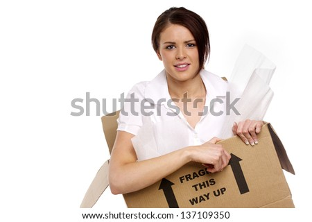 Beautiful business woman stuck in a cardboard box isolated on a white background