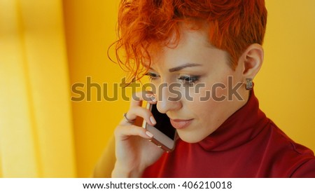 Beautiful business woman talking on mobile phone. Young smiling woman using smartphone. Closeup portrait of happy girl holding mobile phone, making conversation call in office, home. Mobile office. - stock photo