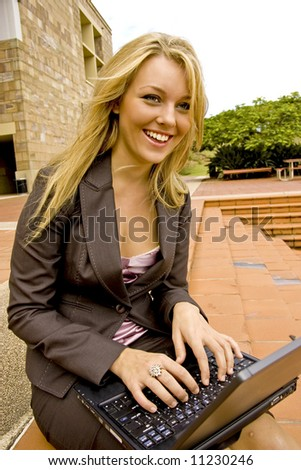beautiful business woman typing on a laptop