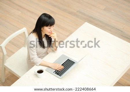 Beautiful business woman using a laptop computer. Portrait of asian. - stock photo