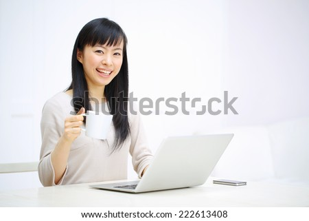 Beautiful business woman using a laptop computer. Portrait of asian. - stock photo