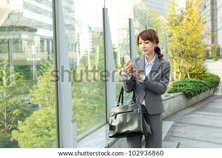 Beautiful business woman walking outside her office. Portrait of - stock photo