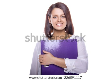 Beautiful business woman with a folder in hands. Business decisions. Office workers. Friendly smiling girl. Isolated