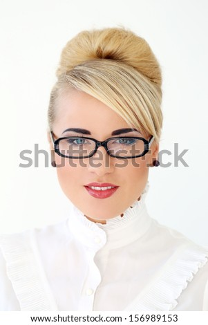 Beautiful business woman with blonde hair and glasses