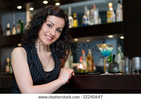 Beautiful business woman with blue cocktail.